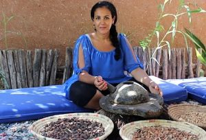 Khadija Fajry grinding seeds with mortar and pestle
