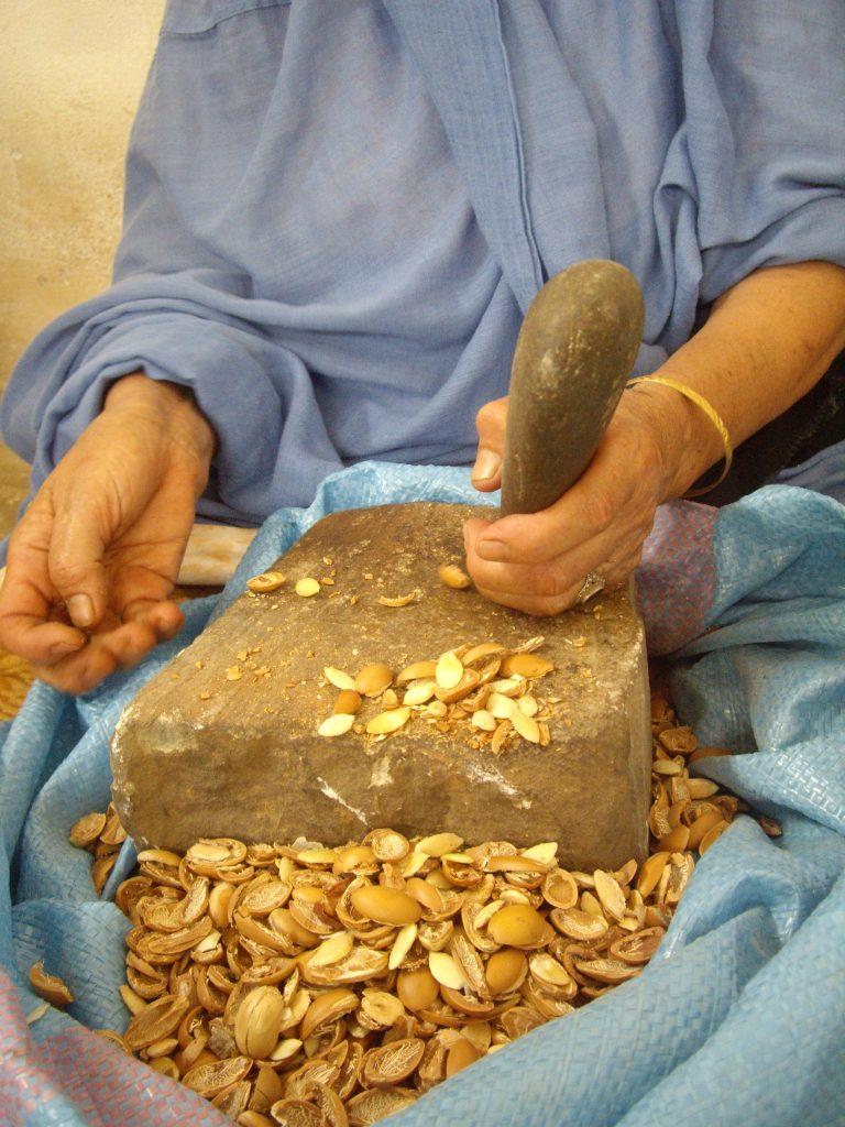 Berber Woman Cracking Argan Nuts in Morocco 2012