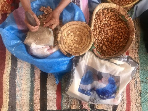 Women cracking Argan nuts in Arazane